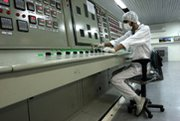 An Iranian technician is shown at the nation's uranium conversion plant near Isfahan in 2007. Six leading governments on Wednesday pledged to pursue a rapid resumption of nuclear talks with Iran (AP Photo/Vahid Salemi).