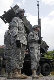 U.S. soldiers in 2010 stand alongside a Patriot air-defense battery in Poland. NATO and Turkey on Tuesday were set to survey areas for potential Patriot deployment near the nation's border with Syria (AP Photo/Czarek Sokolowski).