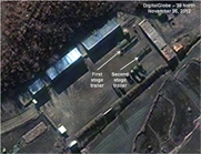 Analysis of satellite images of North Korea's launch site at Dongchang-ri indicates that trailers carrying two rocket stages are now near a missile assembly structure (AP Photo/DigitalGlobe).