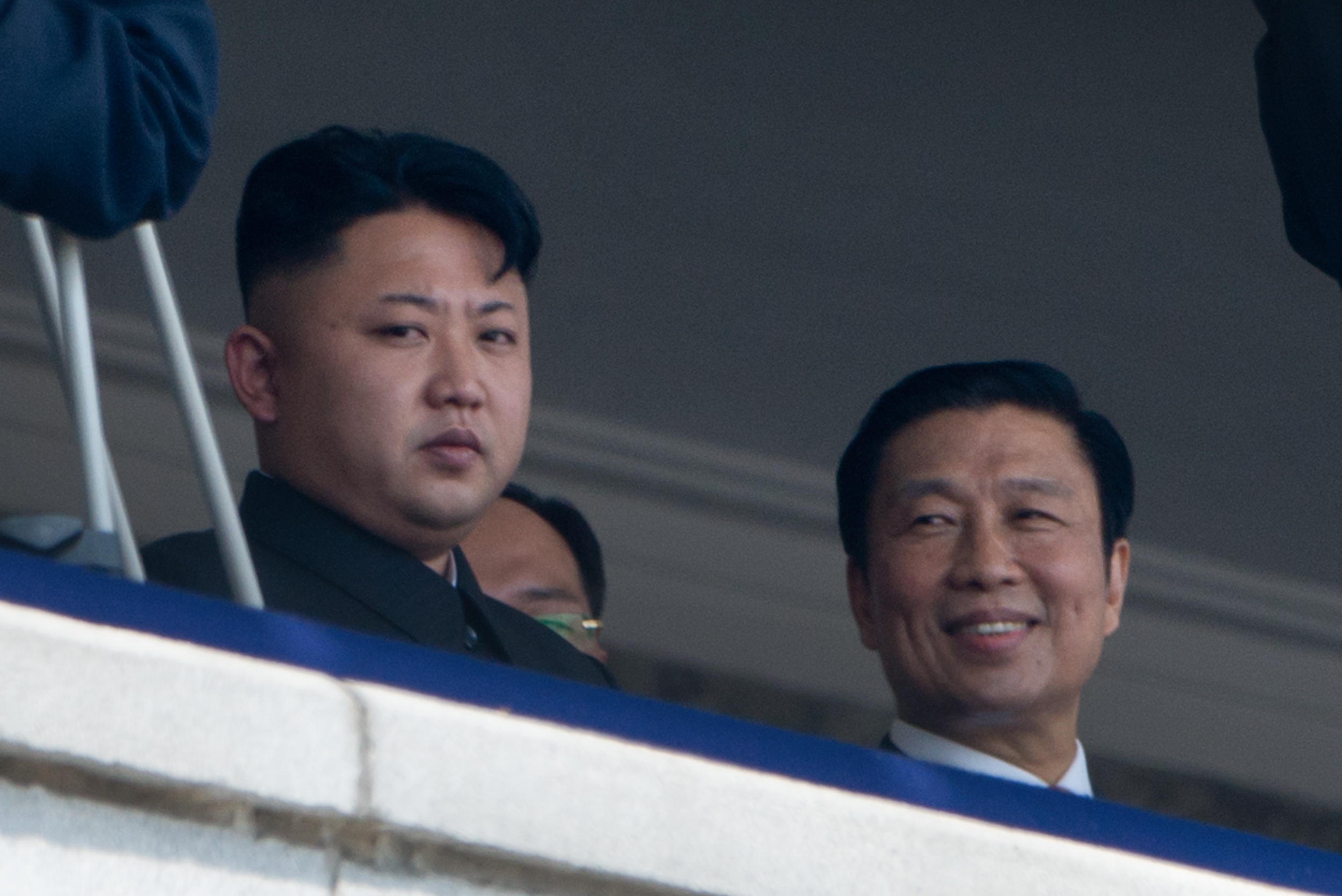 North Korean leader Kim Jong-Un (left) sits with Chinese Vice President Li Yuanchao during a July parade in Pyongyang. China's zeal for quickly resuming frozen nuclear negotiations with the North is not shared by the United States and other participating countries, some analysts say (Ed Jones/AFP/Getty Images).