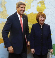 U.S. Secretary of State John Kerry, left, poses with European Union foreign policy chief Catherine Ashton meeting on Friday with Iran's foreign minister. Stalled attempts by U.S. senators to advance sanctions legislation targeting Iran reveal deep divides in Washington over whether the proposals would pressure Tehran to curtail its atomic activities, according to experts (Jason Reed/AFP/Getty Images).