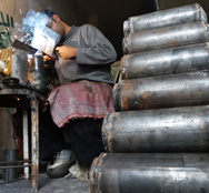 A Syrian rebel fighter on Saturday prepares mortar shells at a workshop in the city of Aleppo. On Monday Reuters reported Western countries plan to block a Syrian-government request for technology for transporting chemical-warfare materials to a coastal city (Fouad Hallak/AFP/Getty Images).