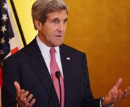 U.S. Secretary of State John Kerry speaks during a reception in her honor of newly sworn-in U.S. ambassador to Japan, Caroline Kennedy, on Tuesday in Washington. Kerry will brief senators on Wednesday about ongoing talks with Iran about its nuclear program, and encourage the lawmakers to delay approval of new sanctions against the Persian Gulf nation (Mandel Ngan/AFP/Getty Images).