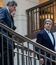Secretary of State John Kerry, right, accompanied by Senator Joe Manchin (D-W.V.), on Wednesday arrives at the Capitol to brief senators on negotiations with Iran about its nuclear program. Key lawmakers said they may still favor heightened sanctions (Win McNamee/Getty Images).