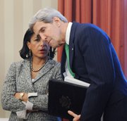 National Security Adviser Susan Rice talks to Secretary of State John Kerry at the White House on Nov. 1. Rice on Wednesday said Israeli Prime Minister Benjamin Netanyahu is getting ahead of himself by warning the international community that a bad deal on Iran's nuclear program could lead to war (Olivier Douliery-Pool/Getty Images).