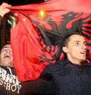 Albanian activists in Tirana on Friday celebrate Prime Minister Edi Rama announcement that Albania will not host the destruction of chemical weapons from Syria (Gent Shkullaku/AFP/Getty Images).