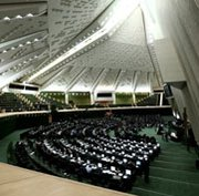 Iran's parliament, shown meeting in August, reportedly could vote on Tuesday on a measure aimed at restricting Tehran's ability to halt contested elements of its nuclear program (Behrouz Mehri/AFP/Getty Images).