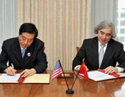U.S. Energy Secretary Ernest Moniz and the minister of the General Administration of China Customs, Yu Guangzhou, in August sign a bilateral accord in Washington on nuclear security cooperation. Questions have been raised about the wisdom of bilateral collaboration between the two powers (U.S. National Nuclear Security Administration photo).