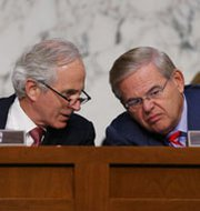 Senate Foreign Relations Committee Chairman Robert Menendez (D-N.J.), right, confers last month with panel Ranking Member Bob Corker (R-Tenn.). Both lawmakers signed a Thursday endorsement of possible bipartisan action in coming weeks to pass new sanctions legislation targeting Iran's disputed atomic activities (Mark Wilson/Getty Images).