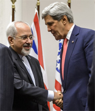 Iranian Foreign Minister Mohammad Javad Zarif shakes hands with Secretary of State John Kerry after a statement on a landmark deal with Iran halting parts of its nuclear program Nov. 24, 2013 in Geneva (Fabrice Coffrini/AFP/Getty Image).