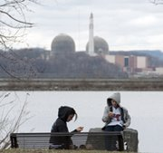 A woman and child eat lunch at a riverside park before the Indian Point Nuclear Power Plant on the banks of New York's Hudson River in 2011. New York state officials and others continue to oppose a proposed federal nuclear waste rule that could enable the plant, and others like it, to continue operating (Don Emmert/AFP/Getty Images).