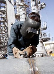 "A technician welds materials at Iran's unfinished Arak heavy-water reactor site in 2004. Tehran's foreign minister on Wednesday indicated his nation would continue ""construction"" at the unfinished facility, though a new international nuclear deal places restrictions on work there (Majid Saeedi/Getty Images)."