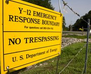 A no-trespassing sign at the Y-12 National Security Complex in Tennessee. U.S. Representative Michael Turner (R-Ohio) on Tuesday expressed doubt that senior managers at Y-12 were not aware of security failings that allowed three activists to intrude deep into the nuclear arms site in July (AP Photo/Erik Schelzig).