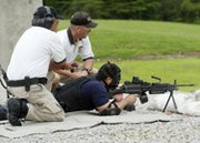 A security patrol officer receives machine-gun training in 2004 at the Y-12 National Security Complex in Tennessee. The Y-12 plant's contract operator on Friday said it would cut business ties with the firm responsible for providing security at the site (AP Photo/Wade Payne).