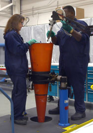 Technicians handle a U.S. W-76 nuclear warhead. W-76 warhead life-extension efforts are in danger of falling behind schedule, the Energy Department's inspector general warned in a report published on Monday (U.S. National Nuclear Security Administration photo).