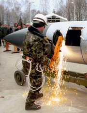 A technician in Ukraine cuts into a Kh-22 air-to-surface missile as part a dismantlement project supported by the Nunn-Lugar Cooperative Threat Reduction initiative. Russia has decided not to extend the CTR program's implementing agreement beyond next year, U.S. State Department officials said in a Russian news report published on Wednesday (U.S. Defense Threat Reduction Agency photo).