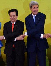 Vietnamese Prime Minister Nguyen Tan Dung and U.S. Secretary of State John Kerry on Wednesday pose for a photo during the 23rd summit of the Association of Southeast Asian Nations in Bandar Seri Begawan, Brunei. The two nations on Thursday signed a nuclear trade pact (ROSLAN RAHMAN/AFP/Getty Images).