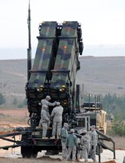 U.S. soldiers work on a Patriot missile system at a Turkish military base in Gaziantep in February. A group of Republican lawmakers has harshly criticized Ankara's plans to negotiate a contract to purchase a missile-defense system from a Chinese company, which they say would undermine U.S. and NATO security (Bulent Kilic/AFP/Getty Images).