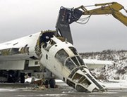 A Tu-160 strategic bomber in Ukraine undergoes dismantlement in 2001 with support from the Nunn-Lugar Cooperative Threat Reduction initiative. The Obama administration on Thursday indicated it was still in talks with Russia on potentially renewing arrangements for Washington to assist in eliminating and securing Soviet-era nuclear weapons and other armaments (AP Photo/Efrem Lukatsky).