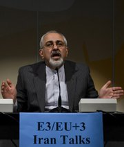 Iranian Foreign Minister Mohammad Javad Zarif on Wednesday addresses reporters following two days of closed-door nuclear talks in Geneva. U.S. analysts are praising President Obama's proposal to free up some of Iran's foreign financial assets if the country scales back its disputed nuclear activities (FABRICE COFFRINI/AFP/Getty Images).