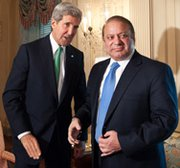 U.S. Secretary of State John Kerry, left, on Sunday meets with Pakistani Prime Minister Nawaz Sharif at the State Department in Washington. The United States has restarted security assistance to Pakistan, officials said on Sunday (NICHOLAS KAMM/AFP/Getty Images).