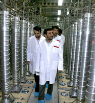 Iranian President Mahmoud Ahmadinejad, center, tours his country's Natanz uranium enrichment facility in 2008. Tehran and Washington each denied a Saturday news report that they had agreed to pursue bilateral talks aimed at resolving international concerns over Iran's nuclear program (AP Photo/Iranian Presidency).