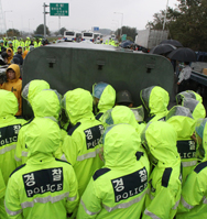 South Korean police officers on Monday block a truck containing anti-North Korea leaflets on a road near the Demilitarized Zone dividing the nations. Seoul barred activists from launching propaganda leaflets into North Korea after Pyongyang threatened to attack in retaliation (AP Photo/Ahn Young-joon).