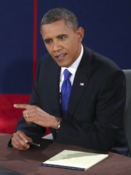 "President Barack Obama, shown participating in a Monday presidential debate. He called for Iranian leaders to ""convince the international community they are not pursuing a nuclear program"" (AP Photo/Win McNamee)."
