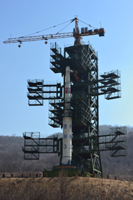 A North Korean Unha 3 rocket before its firing from the Dongchang-ri missile complex in April 2012. New satellite images show the North is continuing to expand the site's facilities, possibly to enable the firing of larger-sized missiles and rockets (Pedro Ugarte/AFP/Getty Images).