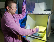 A researcher shows nuclear-forensics samples at the Argonne National Laboratory in Illinois. A new report recommends Russia and the United States establish procedures for sharing sensitive atomic-forensic data in order to counter the threat of nuclear terrorism (U.S. Argonne National Laboratory photo).