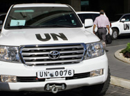 U. N. vehicles leave a Damascus hotel on Thursday, after international-disarmament experts began their mission to catalog Syria's arsenal of chemical weapons (Louai Beshara/Getty Images).