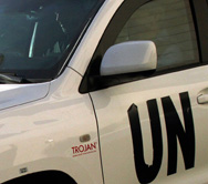 A U.N. vehicle carrying inspectors from the Organization for the Prohibition of Chemical Weapons on Tuesday leaves a Damascus hotel. The chemical-weapons watchdog said it will send a second team of inspectors to bolster its effort to destroy Syria's arsenal (AFP/Getty Images).