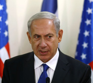 "Israeli Prime Minister Benjamin Netanyahu, shown earlier this week, on Tuesday said he would soon confer with President Obama on ""stopping Iran's nuclear program"" (AP Photo/Larry Downing)."
