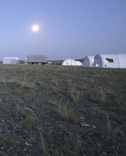 Comprehensive Test Ban Treaty Organization inspectors camp at Kazakhstan's Semipalatinsk Test Site during an inspection exercise in 2008. A sense of quiet and barrenness now pervades the enormous testing grounds that once hosted hundreds of nuclear device detonations during the Cold War (AP Photo/Andreas Persbo).