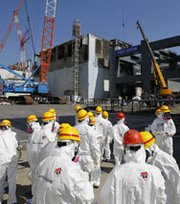 The Fukushima nuclear-power plant in Japan pictured on March 6, ahead of the second anniversary of the tsunami and earthquake that knocked out the facility's power and cooling systems, causing reactor meltdowns and spewing radiation into the air, soil and water. In the United States, newly obtained government documents are prompting concerns among critics that Environmental Protection Agency officials are seeking to relax public-health standards in new guidelines for nuclear-incident response, a claim the agency denies (AP Photo/Issei Kato).