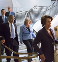 House Minority Leader Nancy Pelosi (D-Calif.), right, and other House lawmakers walk to an intelligence briefing on Syria on Wednesday (AP Photo/J. Scott Applewhite).