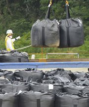 Bags of contaminated waste resulting from the 2011 Fukushima nuclear plant disaster in Japan are placed at a temporal storage site on Wednesday. In the United States, critics fear a presentation the Environmental Protection Agency made to Japan provides evidence of a movement to relax U.S. rules for disposing of radioactive waste (AP Photo/Kyodo News).