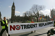 Anti-nuclear protestors block a London road in 2007. The Liberal Democrats, the junior party in the British coalition government, have adopted a policy calling for reducing the number of planned ballistic-missile submarines (AP Photo/Alastair Grant).