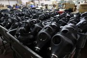 Chemical gas masks await dispersal at an Israeli factory in late August. Russia hopes that Syria's promise to give up its chemical arsenal will create momentum for holding a conference on banning weapons-of-mass-destruction in the Middle East (AP Photo/Tsafrir Abayov).