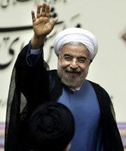 Iran's new president, Hassan Rouhani, waves after being sworn in at the parliament in Tehran on Aug. 4. He reportedly is considering closing an Iranian uranium-enrichment site if the United States and other governments end economic sanctions against his country (AP Photo/Ebrahim Noroozi).