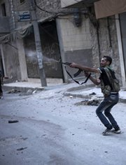A Free Syrian Army fighter fires on government positions on Wednesday in the city of Aleppo. Iran has supplied arms to the Syrian regime in violation of international sanctions targeting Tehran's nuclear program, the United States and other Western powers asserted on Thursday (AP Photo/Manu Brabo).