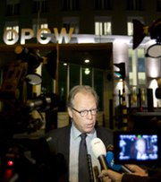 A spokesman for the Organization for the Prohibition of Chemical Weapons on Friday speaks outside the agency's headquarters in The Hague, Netherlands. An OPCW advance team on Monday left the country to start a mission aimed at auditing and destroying the Syrian government's chemical-warfare stockpile (AP Photo/Peter Dejong).