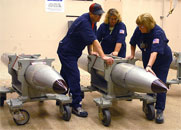 Technicians at the Pantex Plant in Texas ready a B-61 nuclear gravity bomb for a 2007 surveillance test. The U.S. Energy Department inspector general reported this week that a key security system at the nuclear arms assembly and disassembly site was at the end of its intended service life (National Nuclear Security Administration photo).