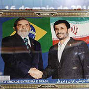 Brazilian President Lula Accepts a Gift from Iranian President Mahmoud Ahmadinejad During Lula's trip to Iran in May 2010