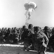 "Troops at ""Camp Desert Rock"" (the Nevada Test Site) observe a mushroom cloud following the test on November 1, 1951."