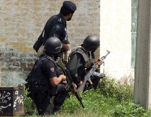 (Apr. 24) -Pakistani police battle masked gunmen last month in Lahore, Pakistan's second largest city (Arif Ali/Getty Images).