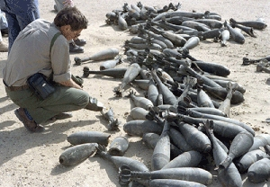 (Apr. 27) -A U.N. inspector examines Iraqi chemical munitions in 1992. Iraq last month declared itself as a chemical weapons possessor state (U.N. photo).