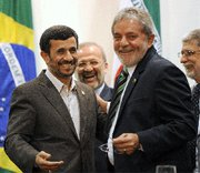"(Nov. 24) -Brazilian President Luis Inacio Lula da Silva (right), meeting yesterday with Iranian President Mahmoud Ahmadinejad, called for a ""just solution"" to the standoff over Iran's nuclear activities (Evaristo Sa/Getty Images)."