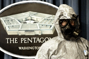(Feb. 1) -A U.S. Army Technical Escort Unit member wears a hazardous-materials suit during a 2002 demonstration of the unit's chemical and biological incident response capabilities. The Pentagon indicated in a report today that it would pursue additional anti-WMD activities (Paul Richards/Getty Images).