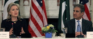 (Mar. 24) -U.S. Secretary of State Hillary Clinton and Pakistani Foreign Minister Shah Mehmood Qureshi, shown taking part today in a discussion in Washington. Qureshi today repeated his country's request for a civilian nuclear trade arrangement with the United States (Mark Wilson/Getty Images).
